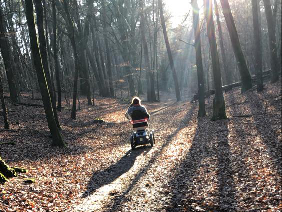 Karin with Scoozy in the Forest.